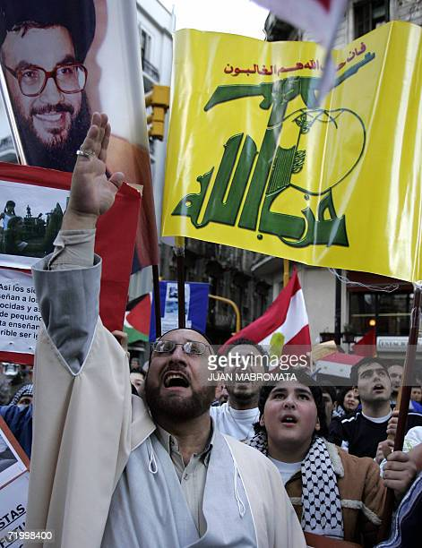 Members of the Islamic community in Argentina shout and hold Hezbollah flags during a demonstration in front of the Israeli Embassy in Buenos Aires...