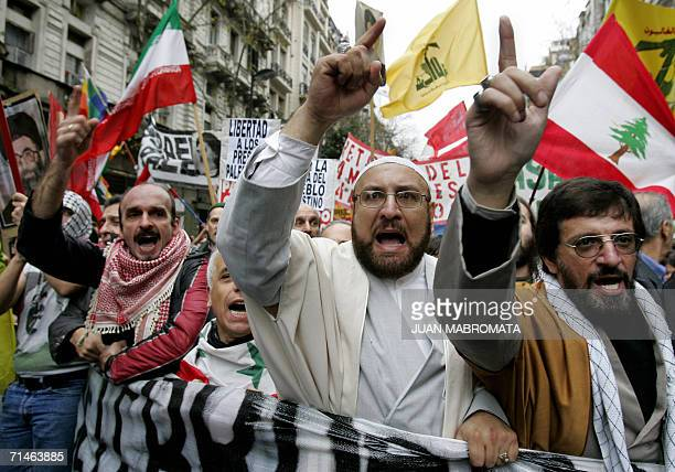 Members of the Islamic community shout slogans during a demonstration in front of the Israeli Embassy in Buenos Aires 17 July 2006 protesting aganist...