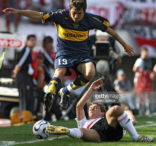 Neri Cardozo of Boca Juniors jumps over Nicolas Domingo of River Plate during a match of the Torneo Apertura 2006 at the Monumental stadium in Buenos...