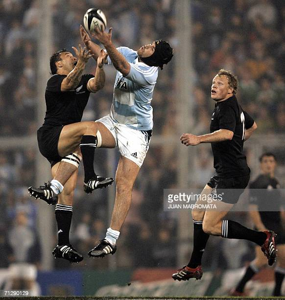 Rico Gear of New Zealand's All Blacks vies for the ball with Ignacio Fernandez Lobbe of Argentina's Los Pumas during their rugby union test match at...