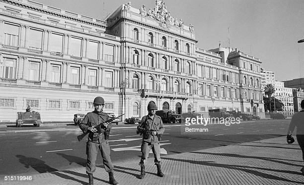 Buenos Aires, Argentina: Soldiers in full war gear stand guard in front of Casa Rosada March 24 after a military Junta, composed of the three Armed...
