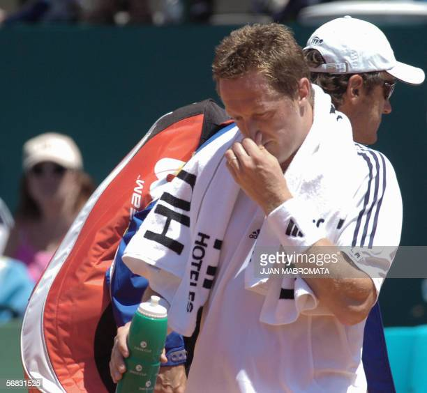 Swedish Jonas Bjorkman leaves the court after losing 60 61 to Argentine Jose Acasuso in their Davis Cup World Group first round ties game at Parque...