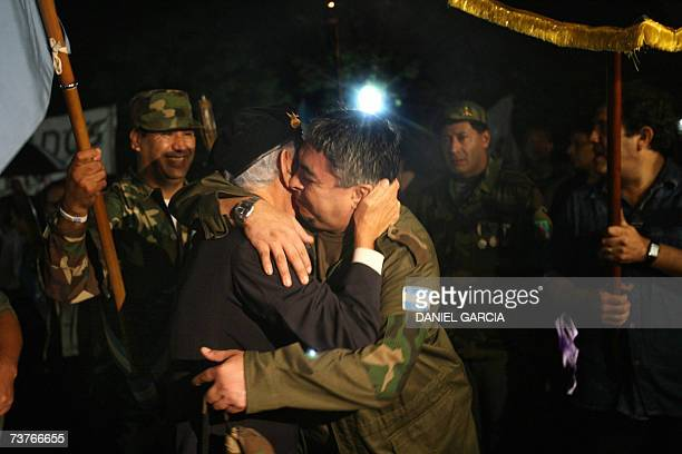 Veterans embrace each other at the cenotaph for the Argentine soldiers killed in combat during the Malvinas/Falkland war in 1982 during the...