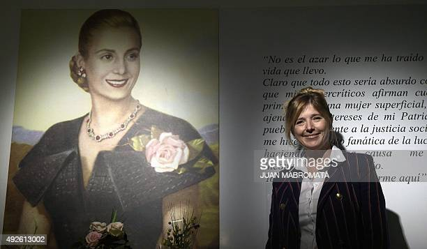 Buenos Aires Government Minister Cristina Alvarez Rodriguez poses next to a portrait of her greataunt Argentine former First Lady Eva Peron before an...