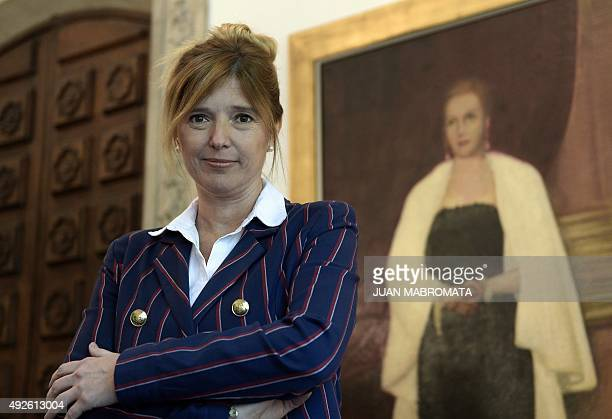 Buenos Aires Government Minister Cristina Alvarez Rodriguez poses next to a painting of her greataunt Argentine former First Lady Eva Peron before an...