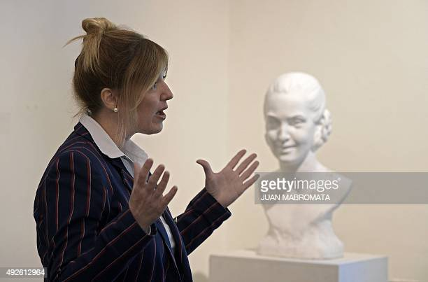 Buenos Aires Government Minister Cristina Alvarez Rodriguez speaks during an interview next to a bust of her greataunt Argentine former First Lady...