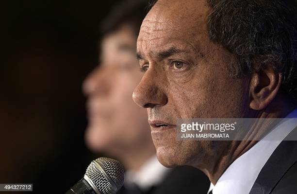 Buenos Aires Governor and presidential candidate for the ruling Frente para la Victoria party Daniel Scioli talks to journalists during a press...