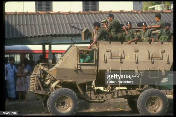 Buffalo armored vehicle manned by Sri Lankan troops as they patrol a street