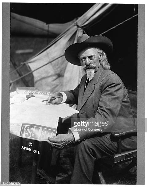 'Buffalo Bill' Cody Holding Map in Tent