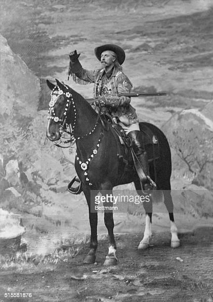 Buffalo Bill Cody on horseback with rifle waving