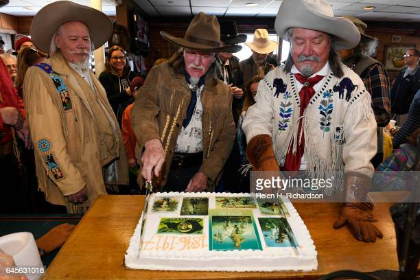 Buffalo Bill impersonators from left to right Buzz Baker Stanley Beug and RD Melfi right get ready to cut the cake during the 100th anniversary of...