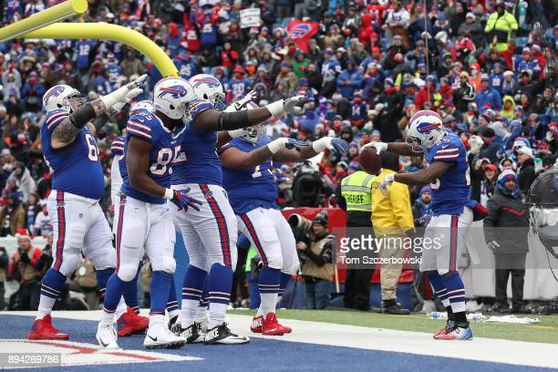 Buffalo Bills celebrate after LeSean McCoy of the Buffalo Bills scored a touchdown during the first quarter against the Miami Dolphins on December 17...