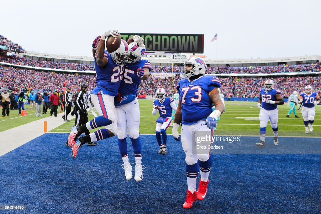 Buffalo Bills celebrate after LeSean McCoy #25 of the Buffalo Bills scored a touchdown during the second quarter against the Miami Dolphins on December 17, 2017 at New Era Field in Orchard Park, New York.