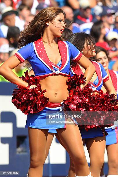 Buffalo Bills cheerleaders the Jills perform during the NFL game against the New England Patriots at Ralph Wilson Stadium on September 25 2011 in...