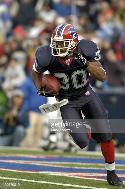 Buffalo Bills defensive back Ko Simpson intercepts a Brett Favre pass in the end zone and returns it for big yardage during a game against the Green...