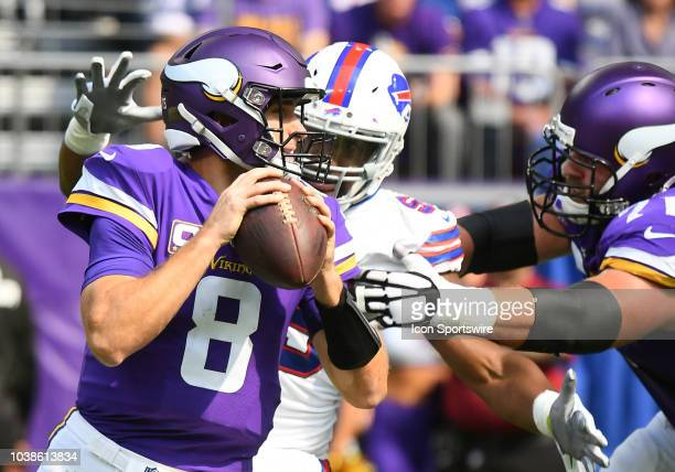 Buffalo Bills Defensive End Jerry Hughes jets around Minnesota Vikings Offensive Tackle Riley Reiff as he eyes Minnesota Vikings Quarterback Kirk...