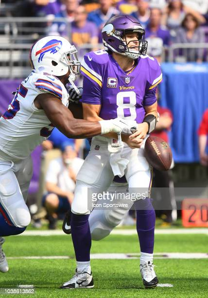 Buffalo Bills Defensive End Jerry Hughes strips Minnesota Vikings Quarterback Kirk Cousins during a NFL game between the Minnesota Vikings and...