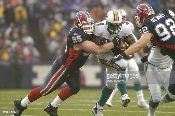 Buffalo Bills defensive lineman Kyle Williams makes a tackle on Dolphins running back Sammy Morris during a game against the Miami Dolphins at Ralph...