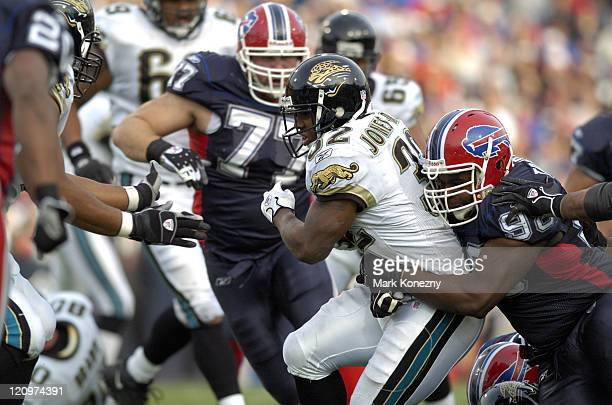 Buffalo Bills defensive lineman Larry Tripplett makes a tackle on Jacksonville Jaguars running back Maurice JonesDrew during a game at Ralph Wilson...
