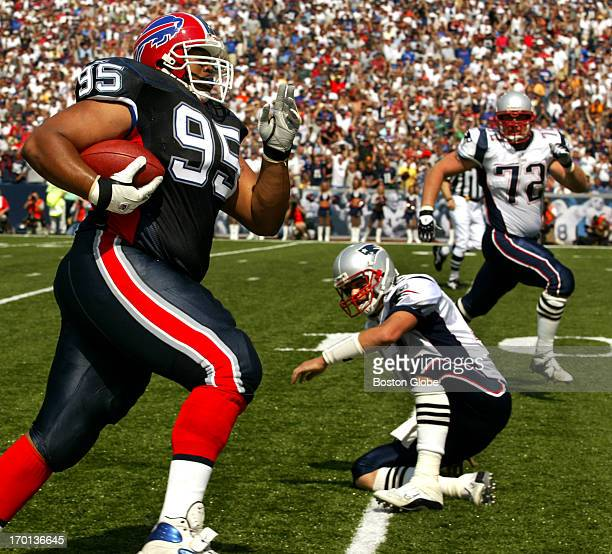 Buffalo Bills defensive tackle Sam Adams left rumbles towards the end zone after intercepting a second quarter pass from Patriots quarterback Tom...
