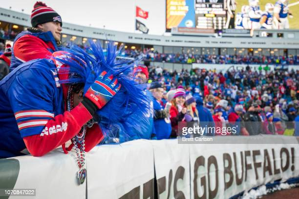 Buffalo Bills fan hangs his head in dejection during the fourth quarter against the New York Jets at New Era Field on December 9 2018 in Orchard Park...