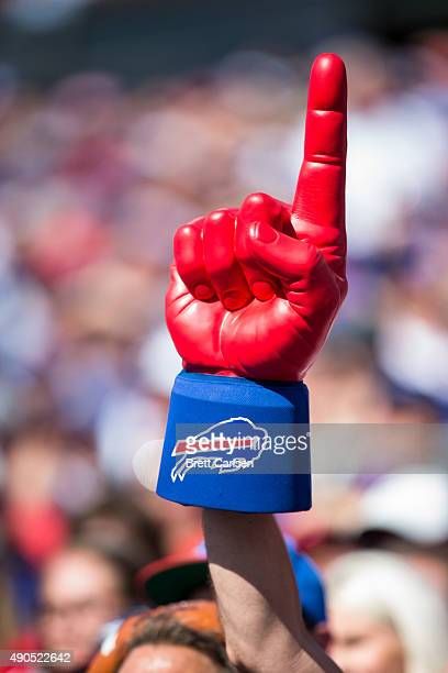 Buffalo Bills fan waves a jumbo foam finger during the game against the New England Patriots on September 20 2015 at Ralph Wilson Stadium in Orchard...