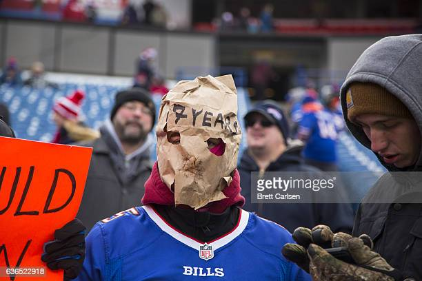 Buffalo Bills fan wears a paper bag with the words 17 YEARS written on the forehead the number of years of the team's playoff drought before the game...