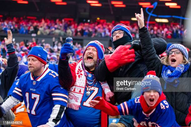 Buffalo Bills fans celebrate a review resulting in a touchdown for the Buffalo Bills during the fourth quarter against the Denver Broncos at New Era...