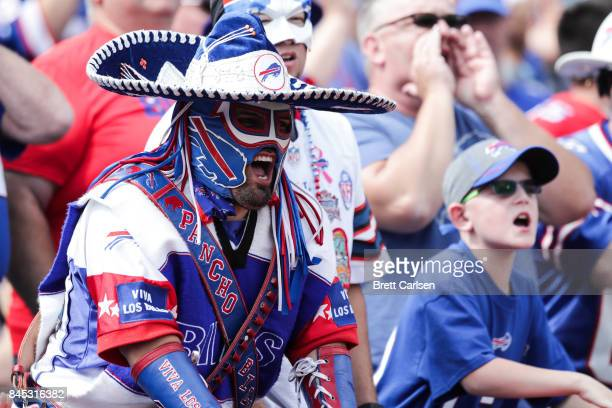 Buffalo Bills fans cheer during the first half against the New York Jets on September 10 2017 at New Era Field in Orchard Park New York