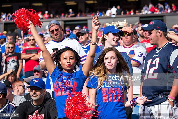 Buffalo Bills fans dance during the second half against the New England Patriots on September 20 2015 at Ralph Wilson Stadium in Orchard Park New...