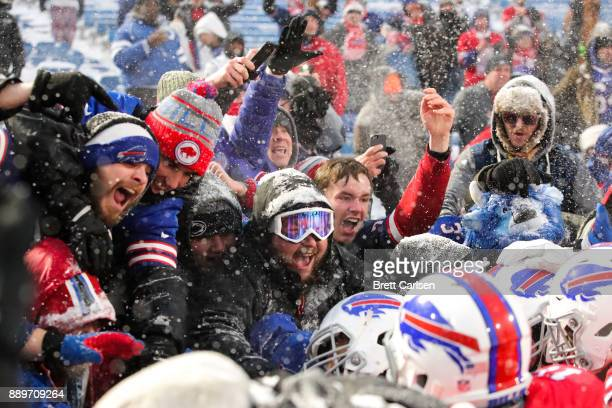 Buffalo Bills fans react as LeSean McCoy of the Buffalo Bills celebrates with them after scoring the game winning touchdown in overtime against the...