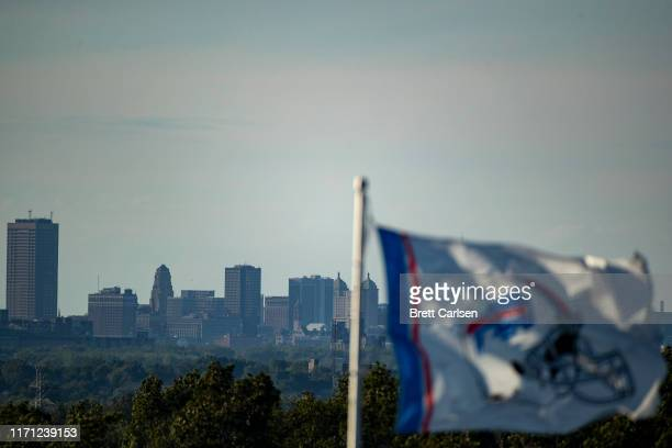 Buffalo Bills flag waves in front of the Buffalo skyline before a preseason game between the Buffalo Bills and the Minnesota Vikings at New Era Field...