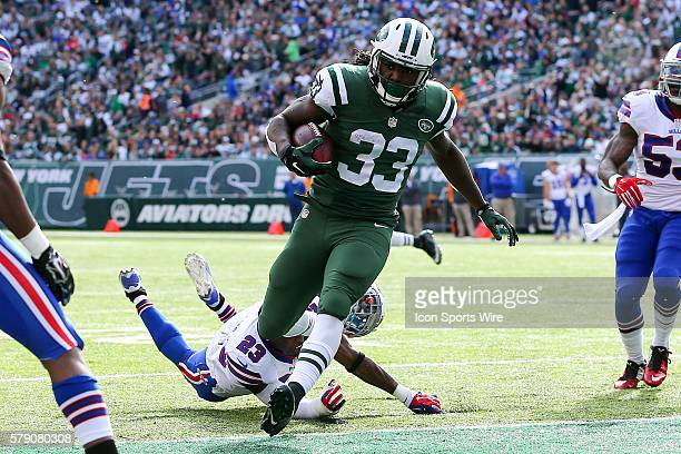 Buffalo Bills free safety Aaron Williams loses his helmet trying to tackle New York Jets running back Chris Ivory on his way to a touchdown during...