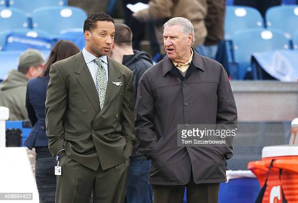 Buffalo Bills General Manager Doug Whaley and Special Assistant Buddy Nix watch the Buffalo Bills and the Kansas City Chiefs warm up on the sidelines...