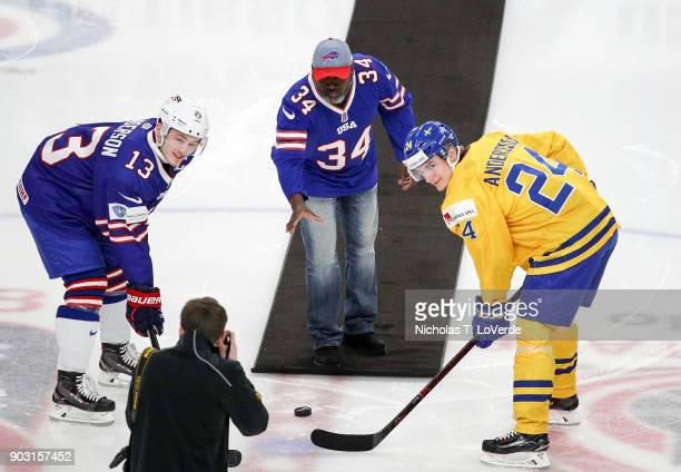 Buffalo Bills Hall of Fame runningback Thurman Thomas drops the puck for the ceremonial faceoff between Joey Anderson of United States and Lias...
