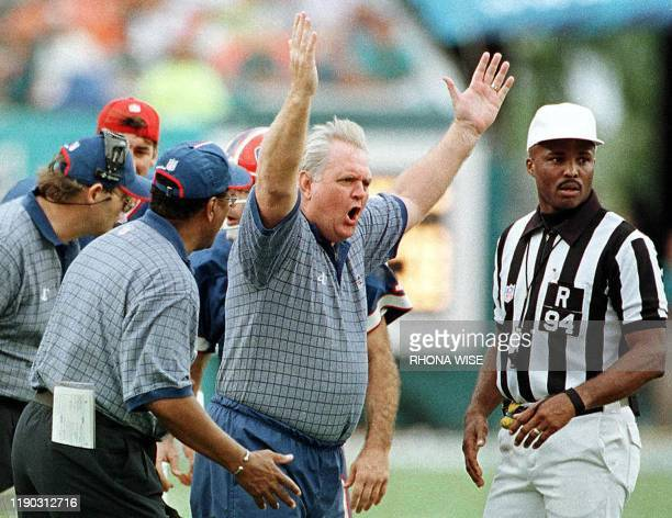 Buffalo Bills head coach Wade Phillips screams at referee Mike Carey and side judge Laird Hayes as he argues a touchdown call during the fourth...