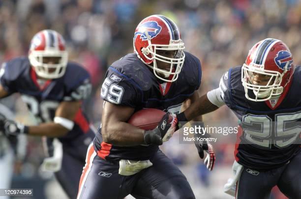 Buffalo Bills linebacker London Fletcher returns a Brett Favre interception for a touchdown in the second quarter at Ralph Wilson Stadium in Orchard...