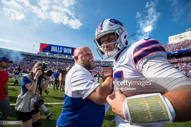 Buffalo Bills offensive coordinator Brian Daboll shakes hands with Josh Allen after the game against the Cincinnati Bengals at New Era Field on...