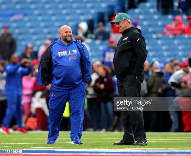 Buffalo Bills offensive coordinator Brian Daboll talks to head coach Doug Pederson of the Philadelphia Eagles before a game at New Era Field on...