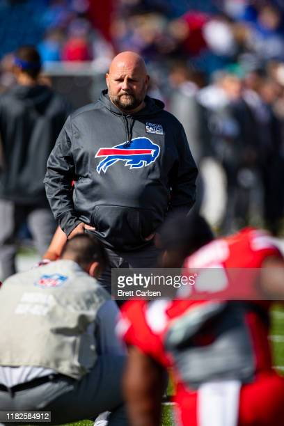 Buffalo Bills offensive coordinator Brian Daboll walks on the field during warm ups for the game against the Miami Dolphins at New Era Field on...