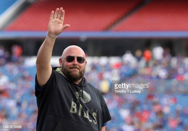 Buffalo Bills offensive coordinator Brian Daboll waves to the crowd during training camp at Highmark Stadium on July 31, 2021 in Orchard Park, New...