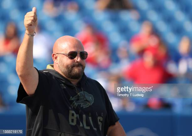 Buffalo Bills offensive coordinator Brian Daboll waves to the crowd before training camp at Highmark Stadium on August 7, 2021 in Orchard Park, New...