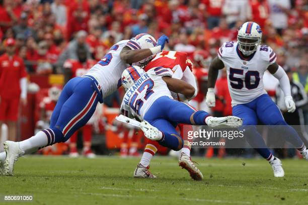Buffalo Bills outside linebacker Lorenzo Alexander and defensive end Jerry Hughes tackle Kansas City Chiefs quarterback Alex Smith after a 4yard gain...
