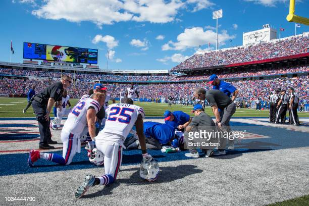 Buffalo Bills players and medical staff gather around Taiwan Jones of the Buffalo Bills after he was hit without his helmet during the third quarter...