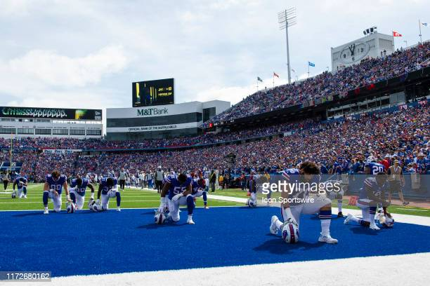 Buffalo Bills players kneel and pray prior to the start of the game between the New England Patriots and the Buffalo Bills on September 29 at New Era...