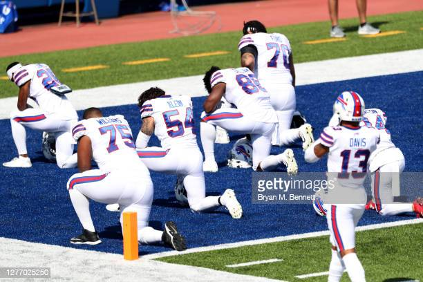 Buffalo Bills players kneel before a game against the Los Angeles Rams at Bills Stadium on September 27, 2020 in Orchard Park, New York.