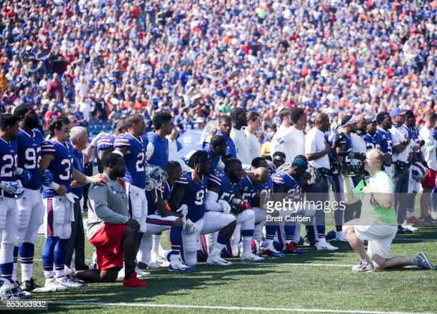 Buffalo Bills players kneel during the American National anthem before an NFL game against the Denver Broncos on September 24 2017 at New Era Field...