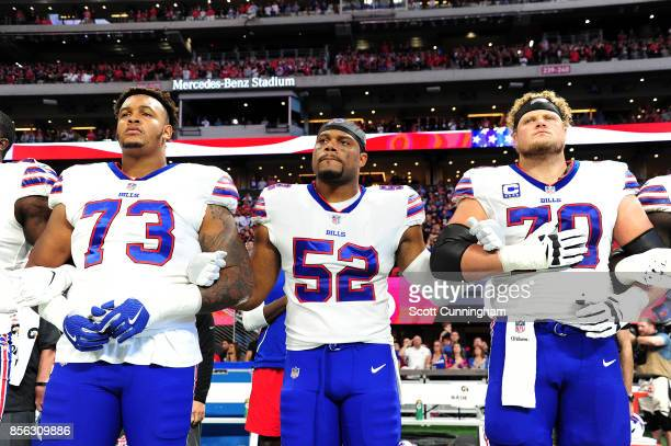 Buffalo Bills players lock arms during the national anthem prior to the game against the Atlanta Falcons at Mercedes-Benz Stadium on October 1, 2017...