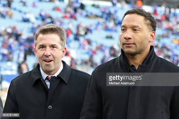 Buffalo Bills president Russ Brandon and Buffalo Bills general manager Doug Whaley walk off the field before the first half between the New York Jets...