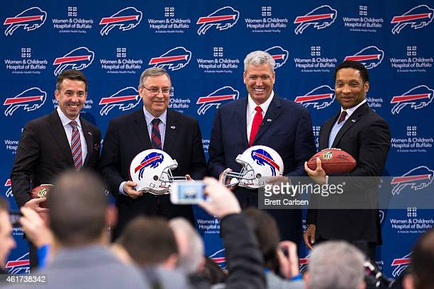 Buffalo Bills President Russ Brandon Owner Terry Pegula Head Coach Rex Ryan and Manager Doug Whaley pose for photos at a press conference announcing...